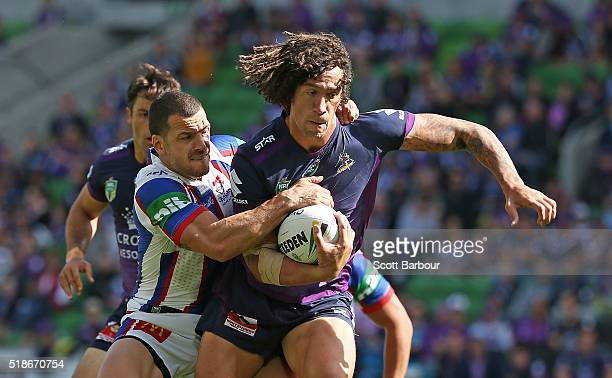 Kevin Proctor of the Storm is tackled during the round five NRL match between the Melbourne Storm and the Newcastle Knights at AAMI Park on April 2...