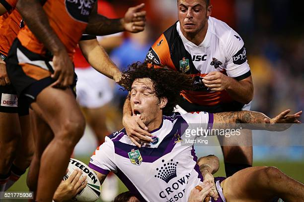 Kevin Proctor of the Storm is tackled during the round seven NRL match between the Wests Tigers and the Melbourne Storm at Leichhardt Oval on April...