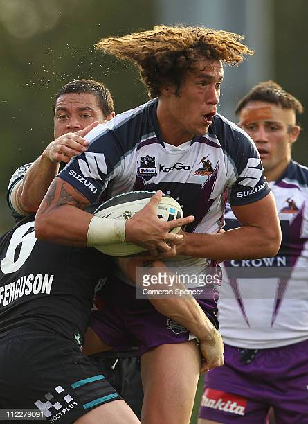 Kevin Proctor of the Storm is tackled during the round six NRL match between the Penrith Panthers and the Melbourne Storm at Centrebet Stadium on...