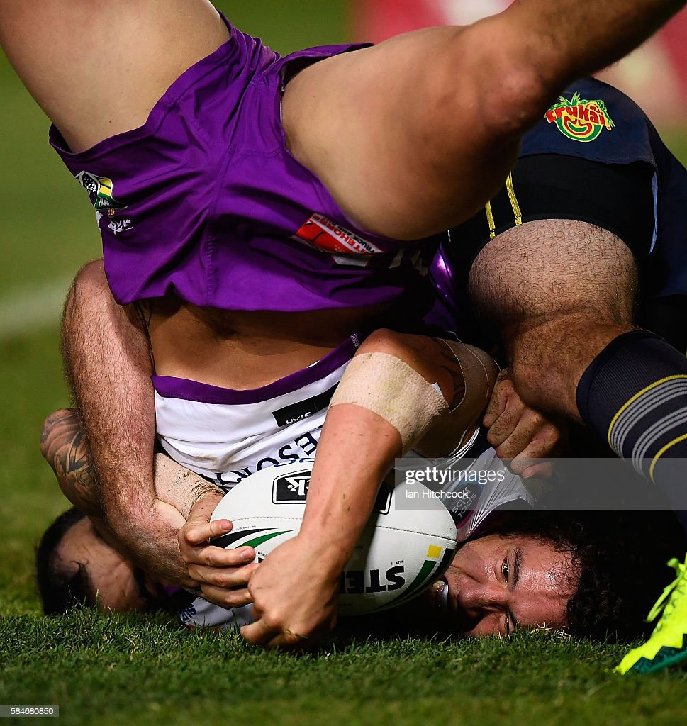 Kevin Proctor of the Storm scores a try during the round 21 NRL match between the North Queensland Cowboys and the Melbourne Storm at 1300SMILES Stadium on July 30, 2016 in Townsville, Australia.