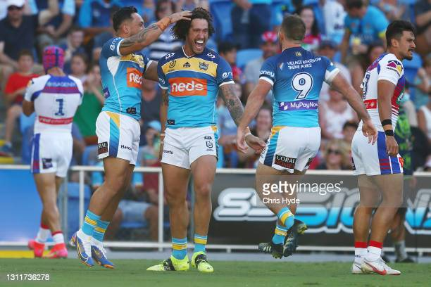 Kevin Proctor of the Titans celebrates a try during the round five NRL match between the Gold Coast Titans and the Newcastle Knights at Cbus Super...