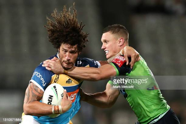 Kevin Proctor of the Titans is tackled by Jack Wighton of the Raiders during the round four NRL match between the Gold Coast Titans and the Canberra...