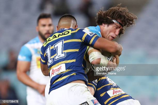 Kevin Proctor of the Titans is tackled by the Eels defence during the round 21 NRL match between the Parramatta Eels and the Gold Coast Titans at ANZ...