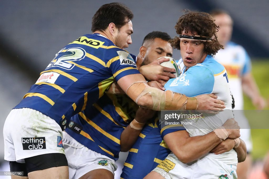 Kevin Proctor of the Titans is tackled by the Eels defence during the round 21 NRL match between the Parramatta Eels and the Gold Coast Titans at ANZ Stadium on August 4, 2018 in Sydney, Australia.
