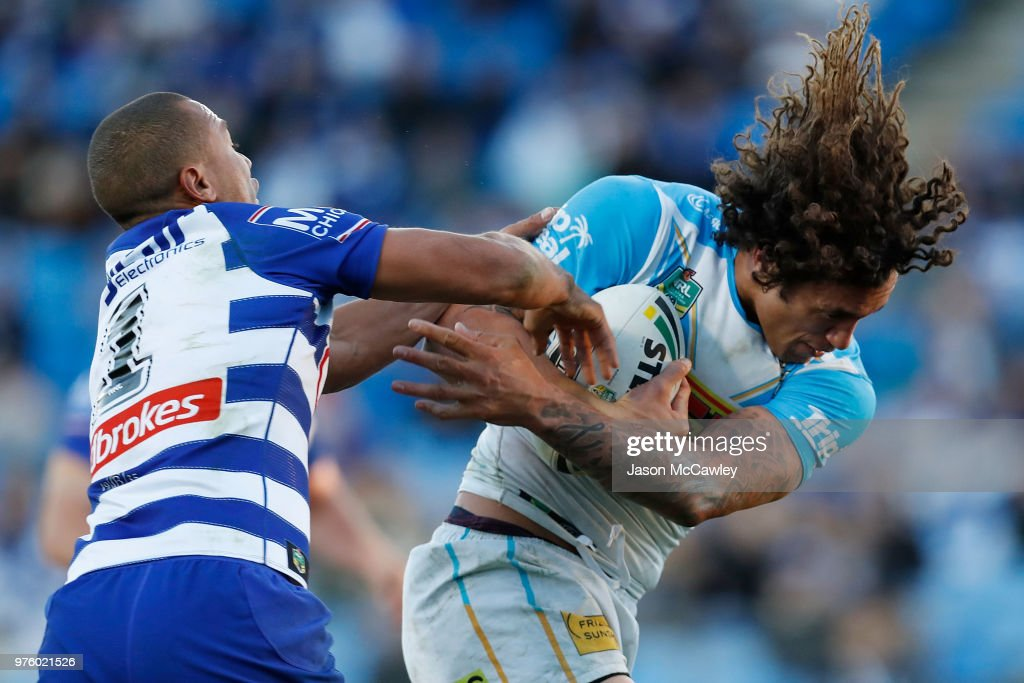 Kevin Proctor of the Titans is tackled during the round 15 NRL match between the Canterbury Bulldogs and the Gold Coast Titans at Belmore Sports Ground on June 16, 2018 in Sydney, Australia.