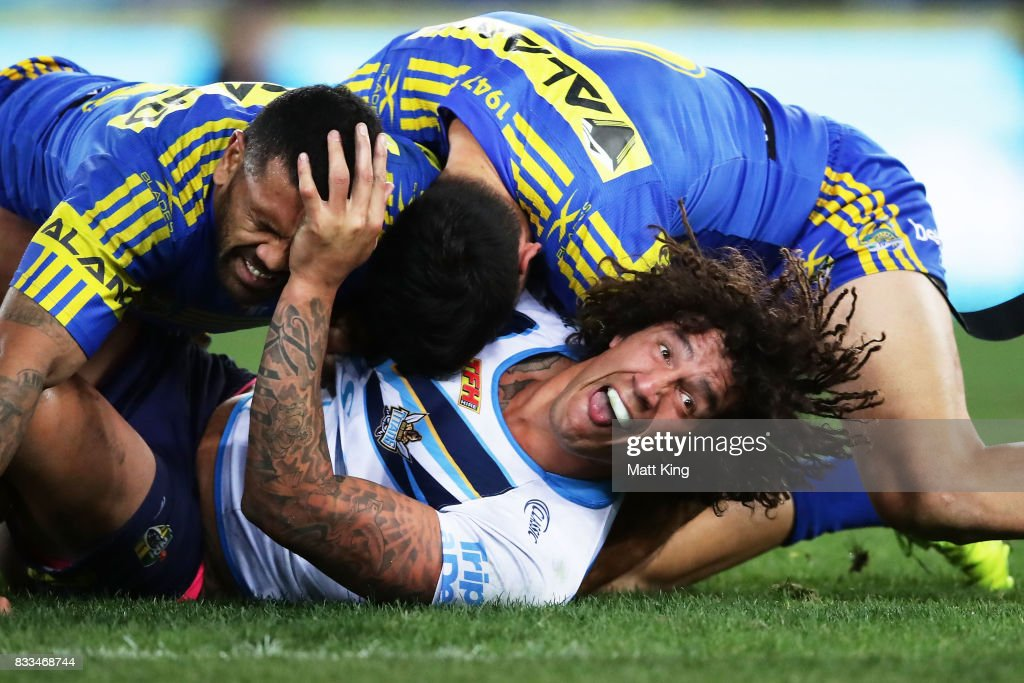 Kevin Proctor of the Titans is tackled during the round 24 NRL match between the Parramatta Eels and the Gold Coast Titans at ANZ Stadium on August 17, 2017 in Sydney, Australia.