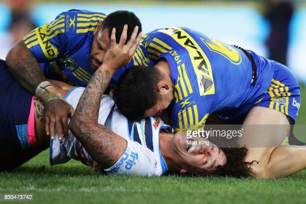 Kevin Proctor of the Titans is tackled during the round 24 NRL match between the Parramatta Eels and the Gold Coast Titans at ANZ Stadium on August...