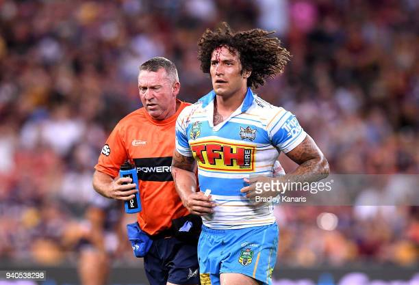 Kevin Proctor of the Titans is taken from the field with a head injury during the round four NRL match between the Brisbane Broncos and the Gold...