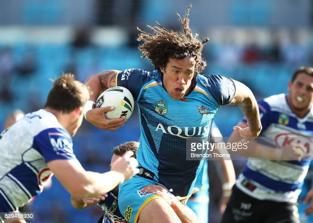 Kevin Proctor of the Titans runs the ball during the round 25 NRL match between the Gold Coast Titans and the Canterbury Bulldogs at Cbus Super...