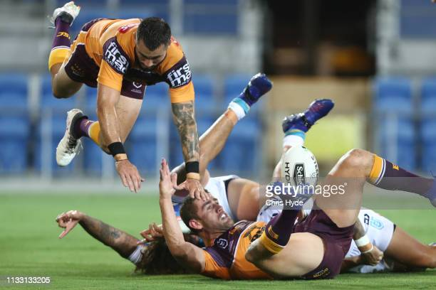 Kevin Proctor of the Titans scores a try during the NRL Trial match between the Brisbane Broncos and the Gold Coast Titans at Cbus Super Stadium on...
