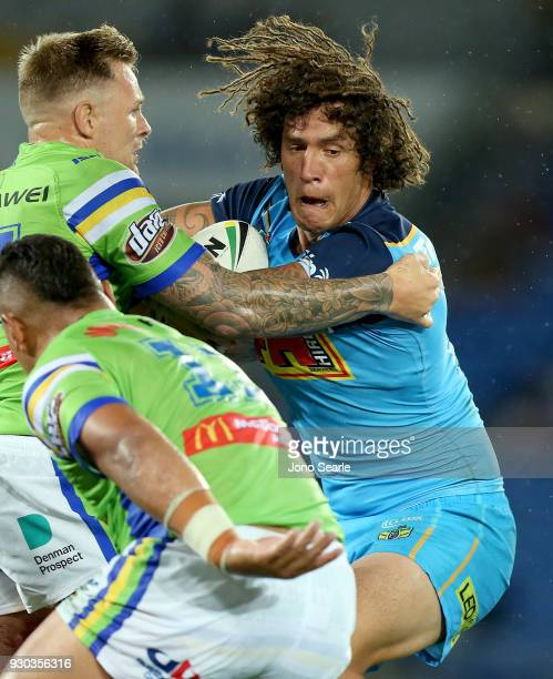 Kevin Proctor of the Titans takes a tackle during the round one NRL match between the Gold Coast Titans and the Canberra Raiders at Cbus Super...