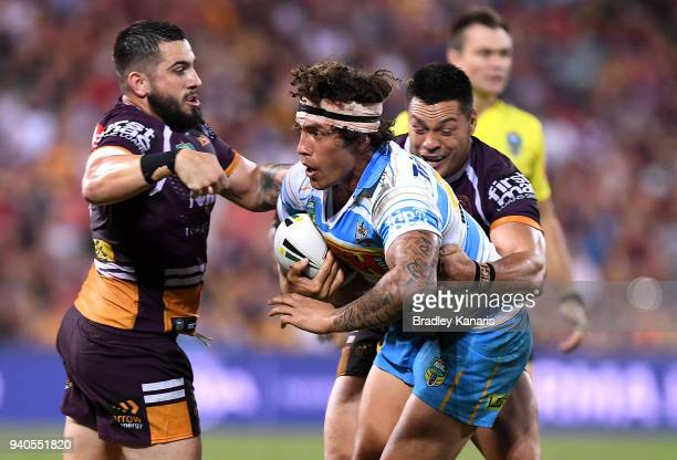 Kevin Proctor of the Titans takes on the defence during the round four NRL match between the Brisbane Broncos and the Gold Coast Titans at Suncorp...