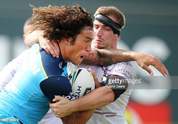 Kevin Proctor of the Titans tries to break through a tackle during the round five NRL match between the Gold Coast Titans and the Manly Sea Eagles at...