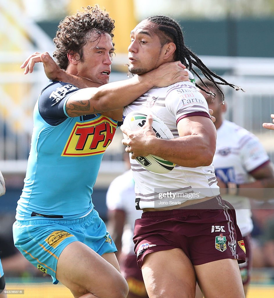 Kevin Proctor of the Titans wraps up Martin Taupau of Manly during the round five NRL match between the Gold Coast Titans and the Manly Sea Eagles at Marley Brown Oval on April 8, 2018 in Gladstone, Australia.