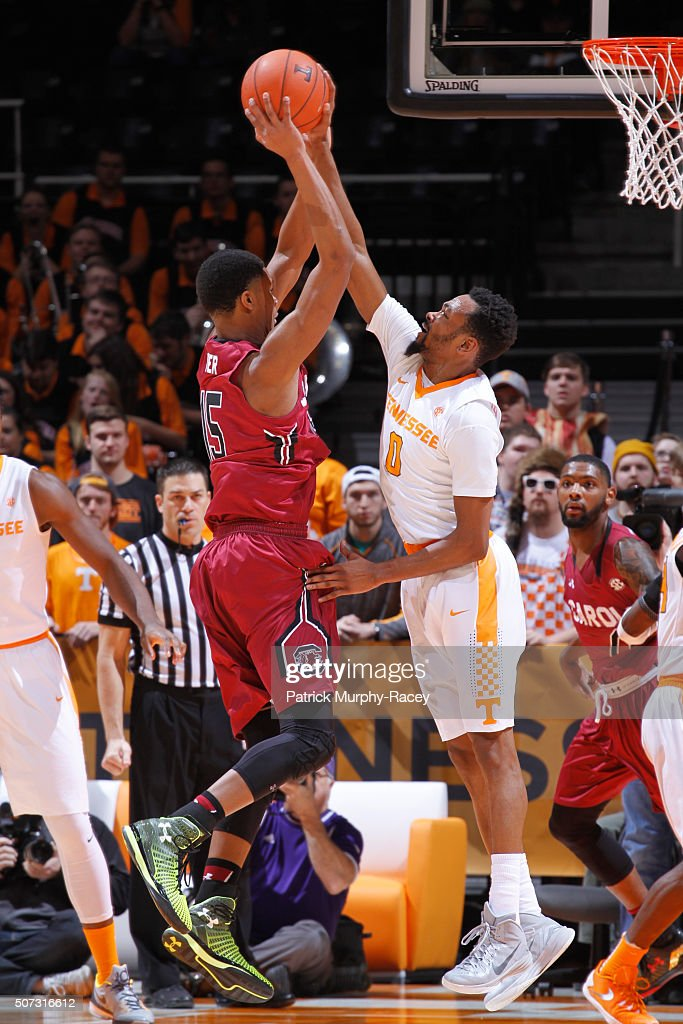 Kevin Punter Jr. #0 of the Tennessee Volunteers steals the ball away from PJ Dozier #15 of the South Carolina Gamecocks in a game at Thompson-Boling Arena on January 23, 2016 in Knoxville, Tennessee.