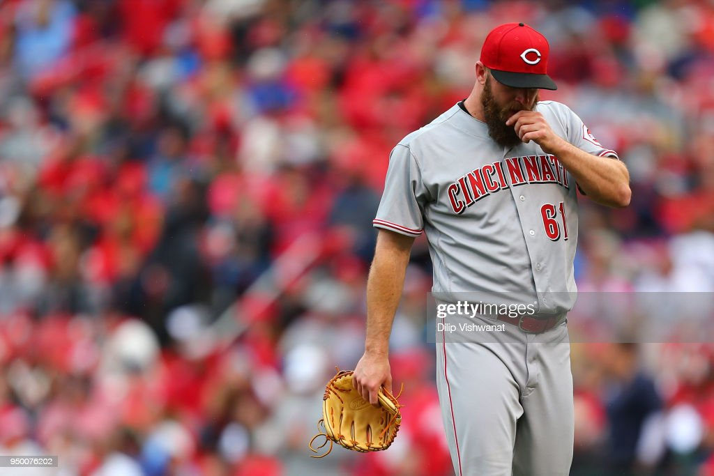 Kevin Quackenbush #61 of the Cincinnati Reds leaves the game in the eighth inning after allowing five runs in two innings against the St. Louis Cardinals at Busch Stadium on April 22, 2018 in St. Louis, Missouri.