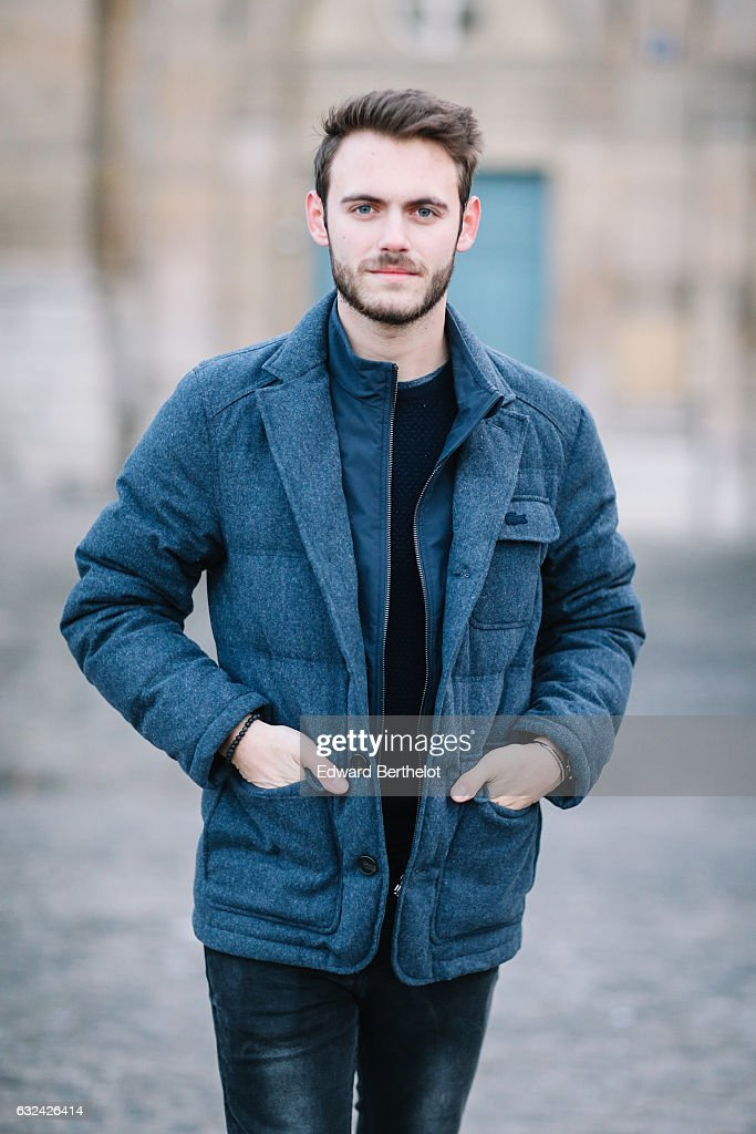 Kevin Ragonneau, fashion and life style blogger, is wearing a Lacoste blue winter coat, a Brice pull over, Zara black denim jeans, and Nike Internationnalist black shoes, during Paris Fashion Week Menswear Fall/Winter 2017/2018, on January 22, 2017 in Paris, France.