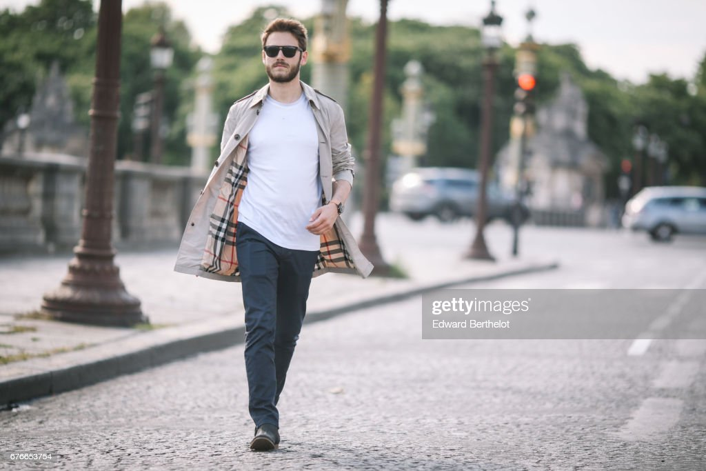 Kevin Ragonneau, fashion and life style blogger, wears a Burberry beige trench coat with tartan inner lining, a Ted Baker t-shirt, San Marina shoes, Solar Eyewear sunglasses, and a Kronaby watch, at Place de la Concorde, on April 29, 2017 in Paris, France.