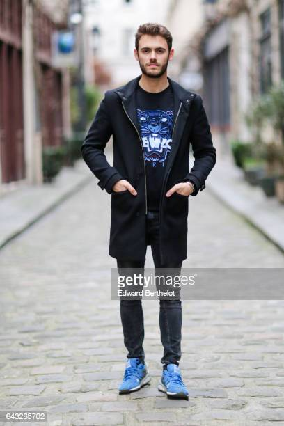 Kevin Ragonneau fashion and life style blogger wears a Carnet de Vol long coat a Kenzo pull over with a printed logo Zara black denim jeans pants and...