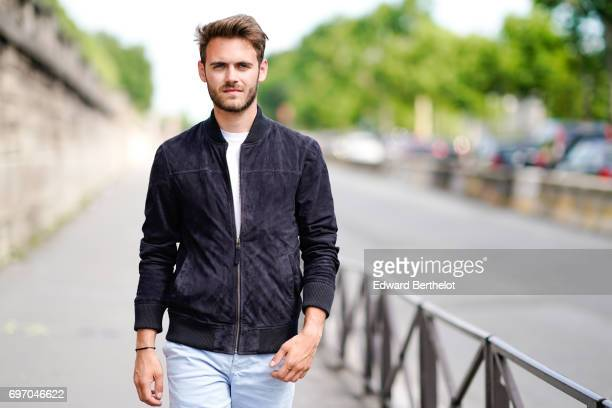 Kevin Ragonneau fashion and life style blogger wears a Jaqk black jacket a Rossignol Apparel white tshirt a Jaqk blue short Asics white sneakers...
