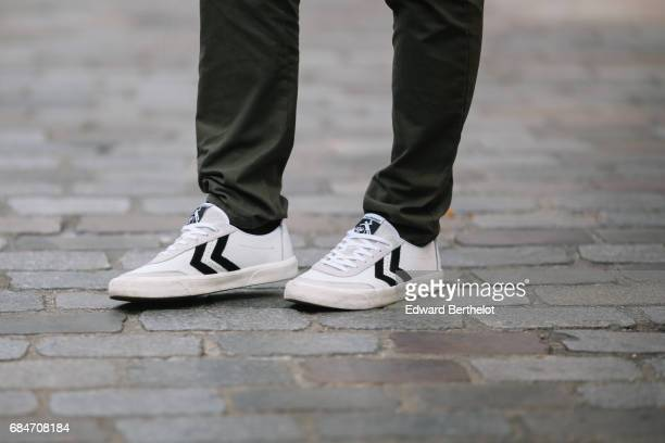 Kevin Ragonneau fashion and life style blogger wears a The Kooples bomber jacket a Hopaal gray tshirt with white prints Zara green pants and Hummel...