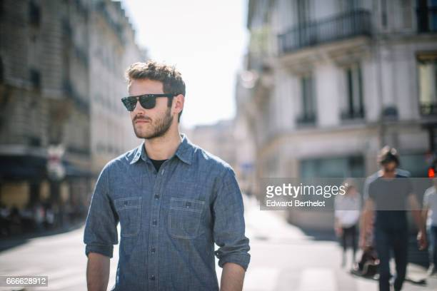 Kevin Ragonneau fashion and life style blogger wears Hummel white sneakers Dockers pants a Dockers blue denim shirt Solar sunglasses a Daniel...