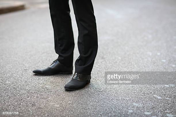Kevin Ragonneau is wearing a Brice black suit a Younger Bresson watch and San Marina black shoes during a street style session on April 21 2016 in...