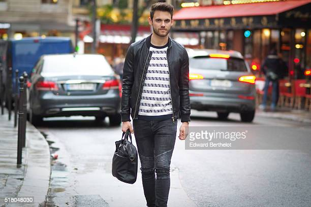 Kevin Ragonneau is wearing a Zara black leather jacket Zara black jeans a Brice black bag a Kapten watch a Pull and Bear striped top and Baron...