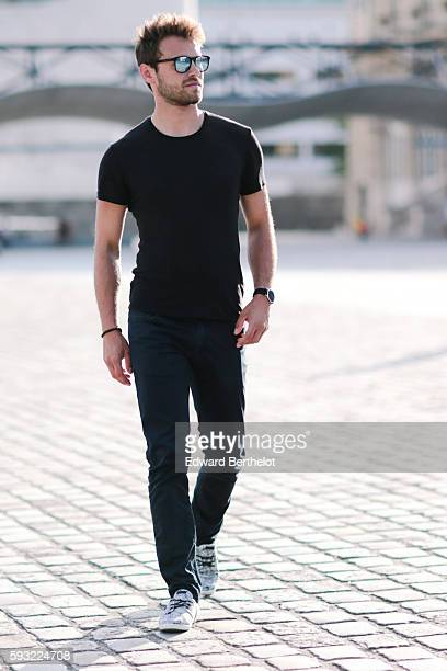 Kevin Ragonneau is wearing Faguo shoes We Fashion blue denim jeans pants a Zara black tshirt Kapten and Son blue sunglasses and a Kapten and Son...