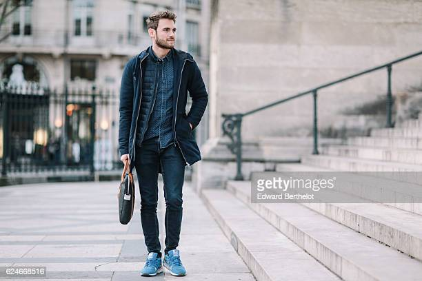 Kevin Ragonneau is wearing New Balance blue shoes Zara black denim jeans a FYU blue shirt a Brice jacket a Pull and Bear trench coat a Tissot watch...