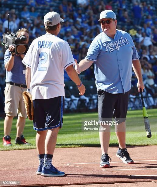 Kevin Rahm and Eric Stonestreet shake hands during the 2017 Big Slick Celebrity Weekend at Kauffman Stadium on June 23 2017 in Kansas City Missouri