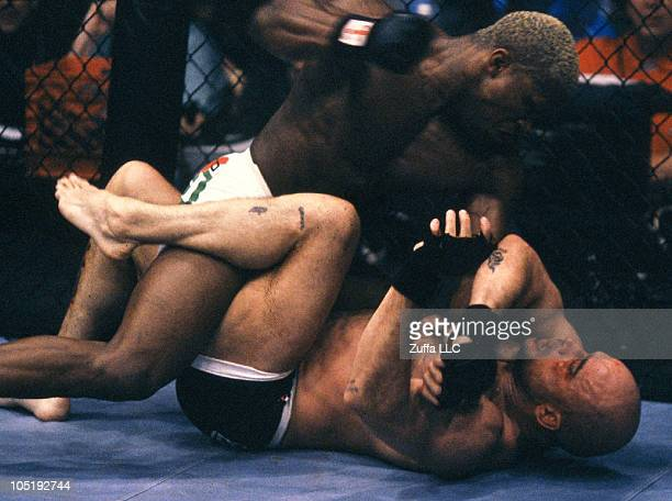 Kevin Randleman punches Bas Rutten during their UFC Heavyweight Championship bout at UFC 20 on May 7 1999 in Birmingham Alabama