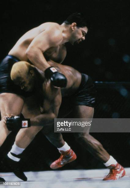 Kevin Randleman shoots for a takedown against Pete Williams in the UFC Heavyweight Championship bout at UFC 23 on November 19 1999 in Chiba Japan