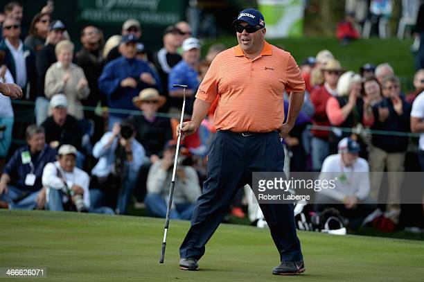 Kevin reacts on the 18th hole during the final round of the Waste Management Phoenix Open at TPC Scottsdale on February 2 2014 in Scottsdale Arizona