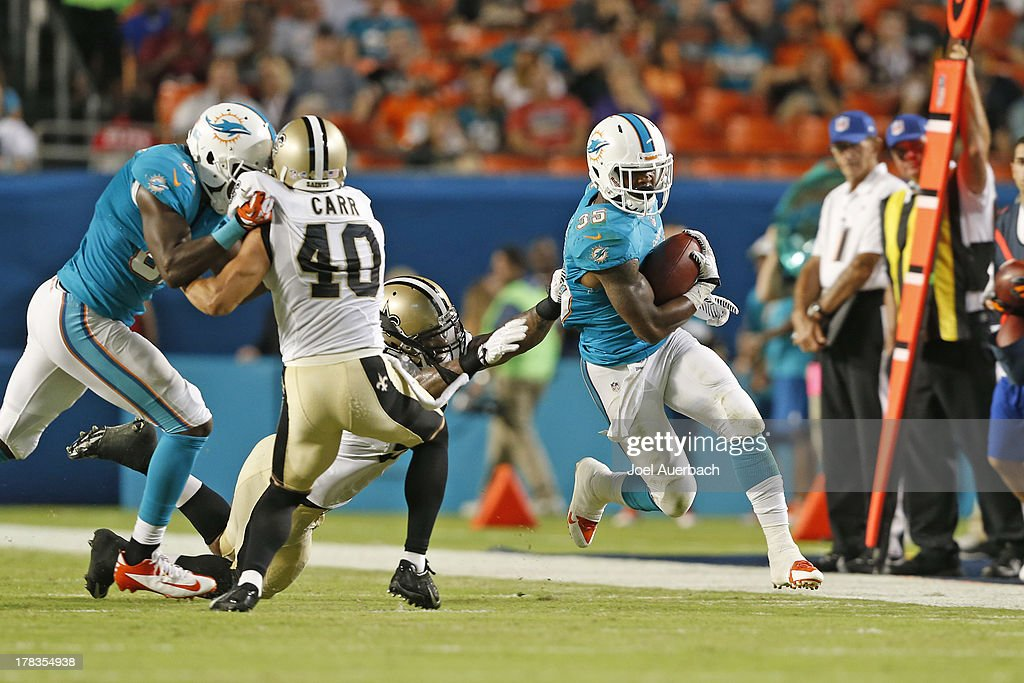 Kevin Reddick #52 Of The New Orleans Saints Is Unable To Tackle Mike  Gillislee #
