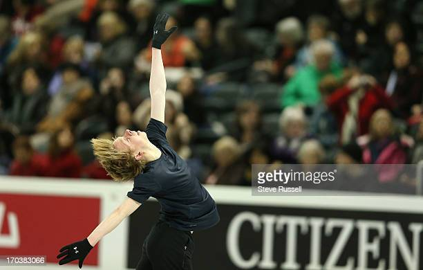 Kevin Reynolds spins as skaters practice their long routine as skaters prepare to compete in the ISU World Figure Skating Championships at Budweiser...