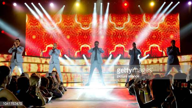 Kevin Richardson Brian Littrell Alexander James McLean Howie Dorough and Nick Carter of the US band Backstreet Boys perform a concert on the stage of...