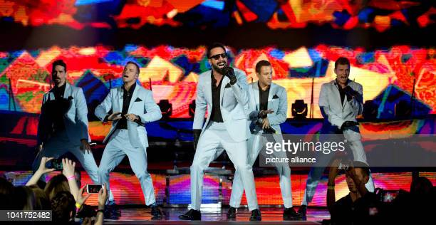 Kevin Richardson Brian Littrell Alexander James McLean Howie Dorough uand Nick Carter of the US band Backstreet Boys perform a concert on the stage...