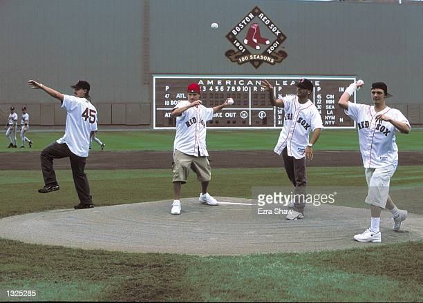 Kevin Richardson Brian Littrell Howie D and Nick Carter of the Backstreet Boys throw out the first pitch during the BravesRed Sox game July 8 2001 at...