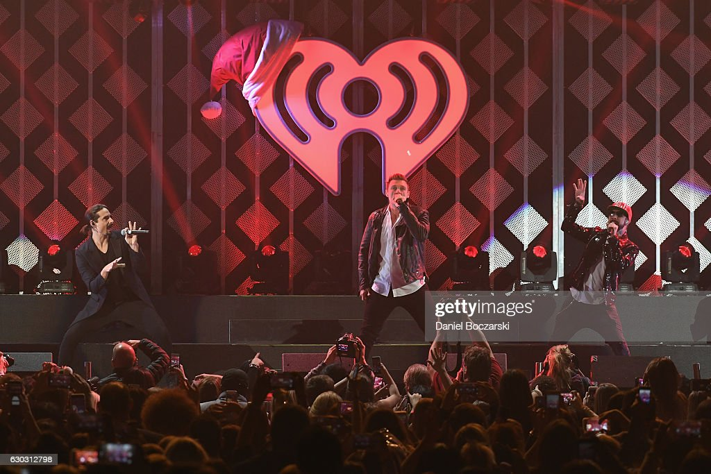 Kevin Richardson, Brian Littrell, Nick Carter, and A. J. McLean of Backstreet Boys perform onstage during 103.5 KISS FM's Jingle Ball 2016 at Allstate Arena on December 14, 2016 in Rosemont, Illinois.