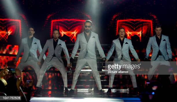 Kevin Richardson Howie Dorough Alexander James McLean Brian Littrell and Nick Carter of the US band Backstreet Boys perform a concert on the stage of...