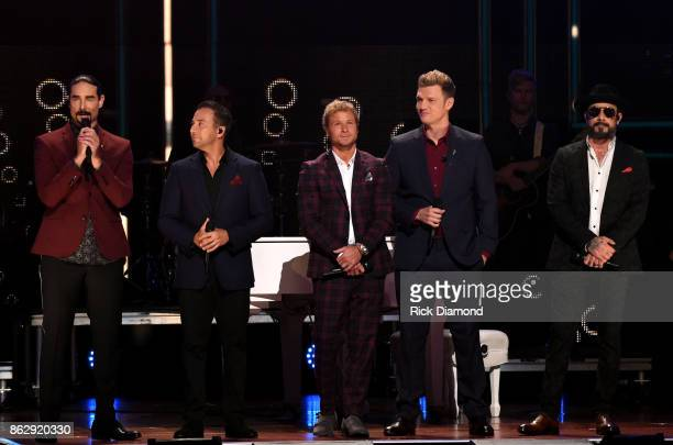 Kevin Richardson Howie Dorough Brian Littrell Nick Carter and AJ McLean of the Backstreet Boys speak onstage at the 2017 CMT Artists Of The Year on...
