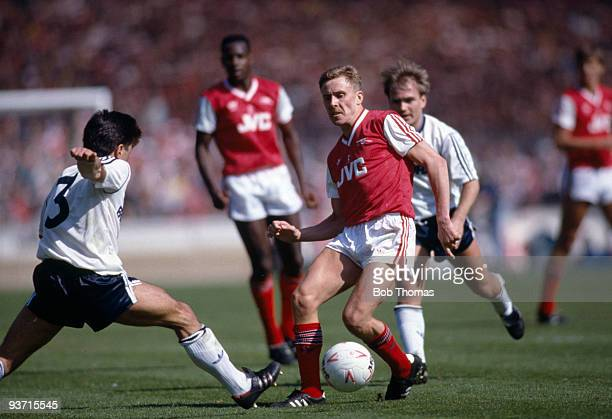 Kevin Richardson of Arsenal is opposed by Rob Johnson of Luton Town during the Littlewoods Cup Final held at Wembley Stadium London on 24th April...