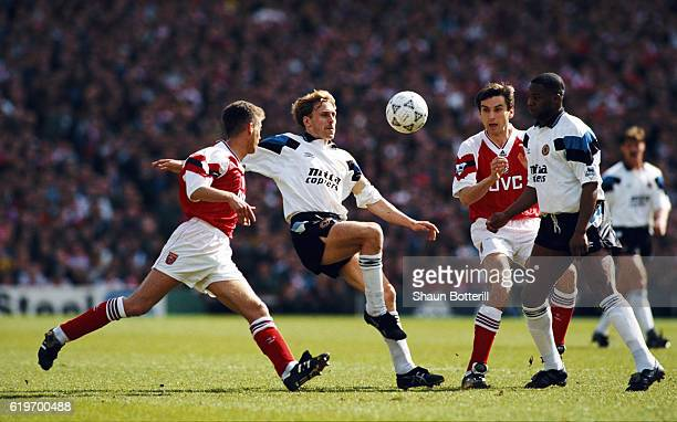 Kevin Richardson of Aston Villa in action watched by Ian Sellley Alan Smith and Dalian Atkinson during a Premier League match between Arsenal and...