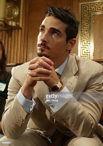 Kevin Richardson of pop group the Backstreet Boys speaks during a news conference June 6 2002 on Capitol Hill in Washington DC The news conference...