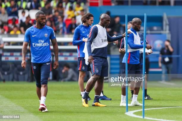Kevin Rimane Zoumana Camara and Lassana Diarra of PSG during the training session of Paris Saint Germain at Parc des Princes on May 16 2018 in Paris...