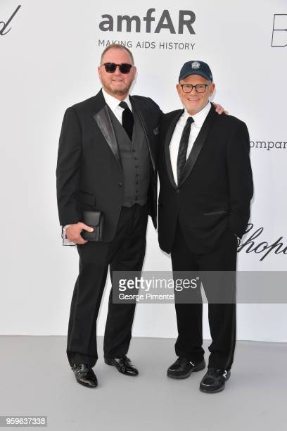 Kevin Robert Frost and Bill Roedy arrive at the amfAR Gala Cannes 2018 at Hotel du CapEdenRoc on May 17 2018 in Cap d'Antibes France