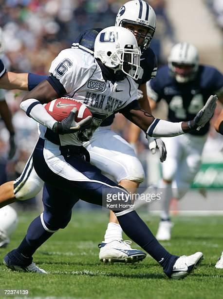 Kevin Robinson of the Utah State Aggies runs with the ball against the Brigham Young Cougars on September 23 2006 at La Vell Edwards Stadium in Provo...
