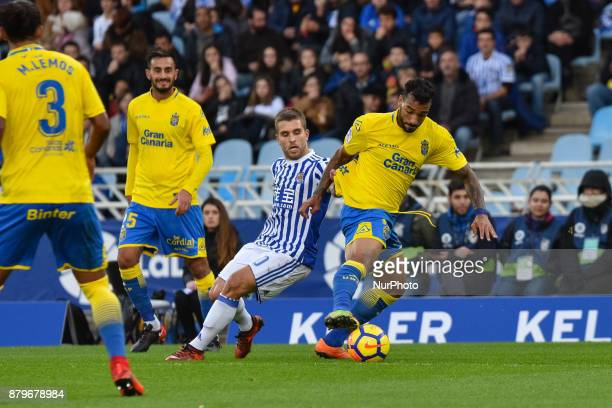 Kevin Rodrigues of Real Sociedad duels for the ball with Aquilani of U D Las Palmas during the Spanish league football match between Real Sociedad...