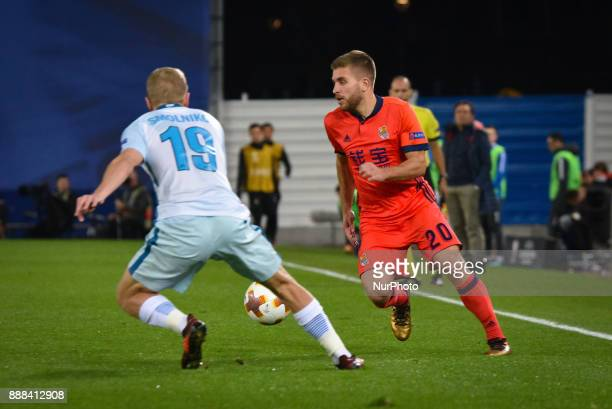 Kevin Rodrigues of Real Sociedad duels for the ball with Igor Smolnikov of Zenit during the UEFA Europa League Group L football match between Real...